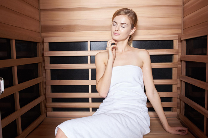 Girl relaxing in sauna
