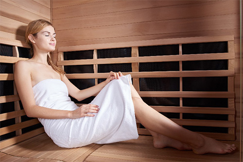 Woman using a sauna for weight loss