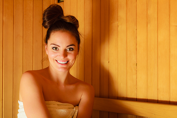 Woman sitting an infrared sauna