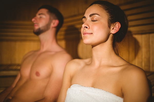 Couple enjoying infrared sauna health benefits