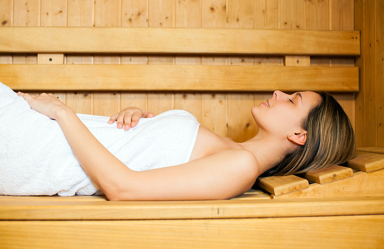Woman relaxing in infrared sauna