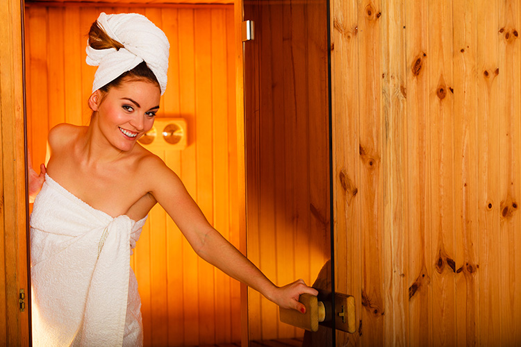 Happy woman in an infrared sauna